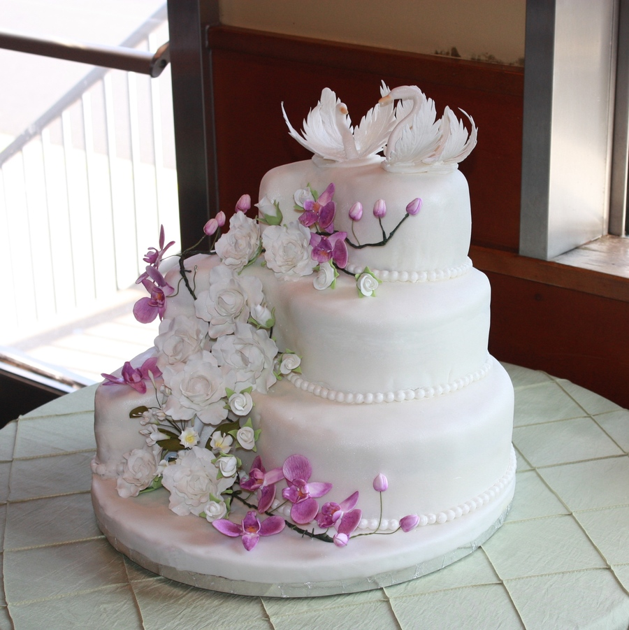 Wedding Cake With Gumpaste Flowers And Swans On Central