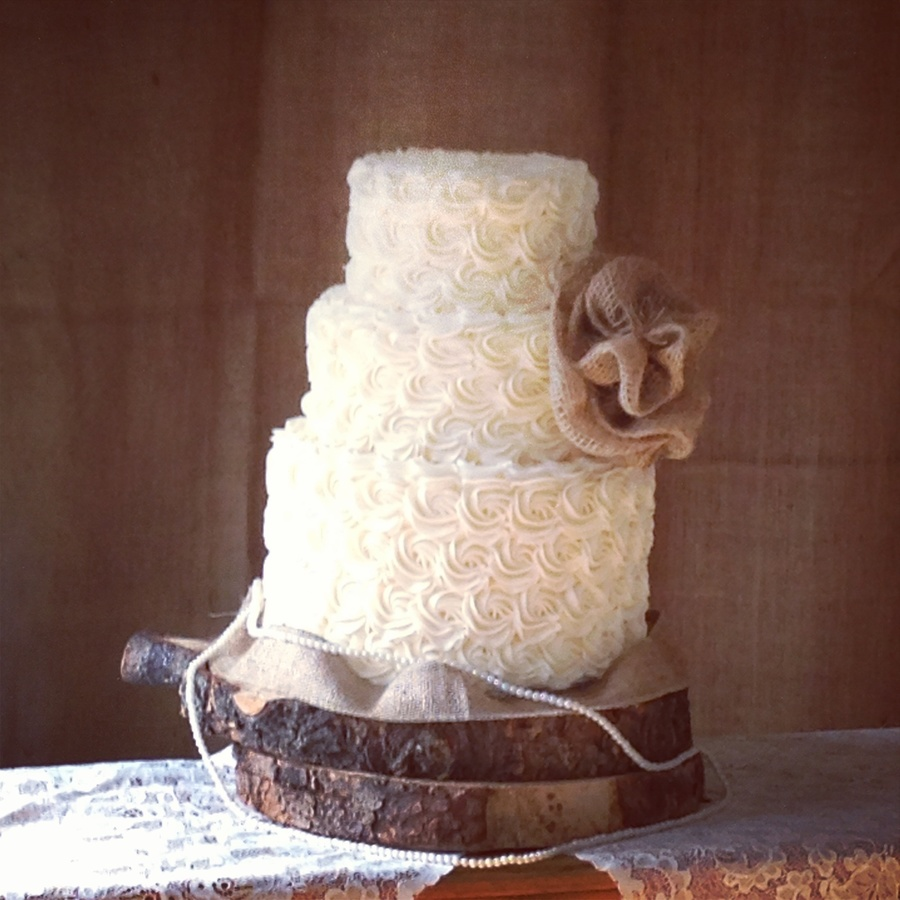 Buttercream Rosettes With A Burlap Flower on Cake Central