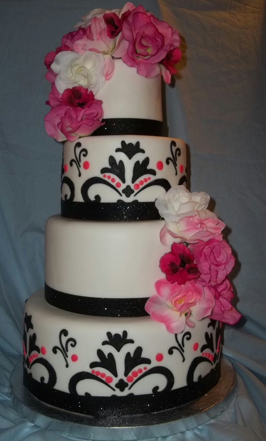 wedding cakes black white and pink four tier pink black and white stenciled wedding cake 23902