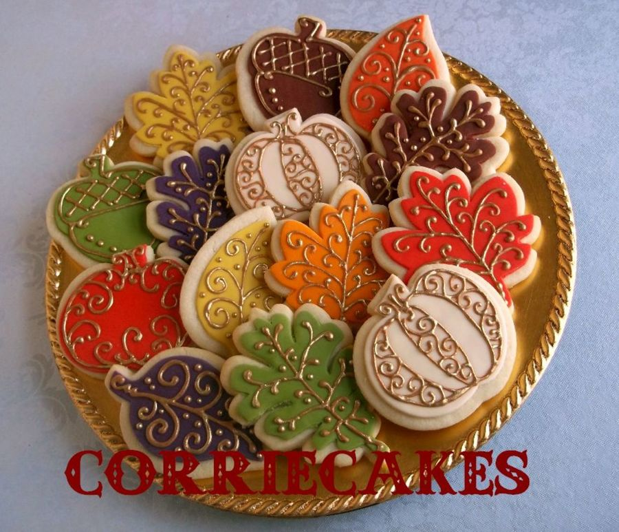 Sugar Cookies Topped With Mmf And Piped Designs In Brown