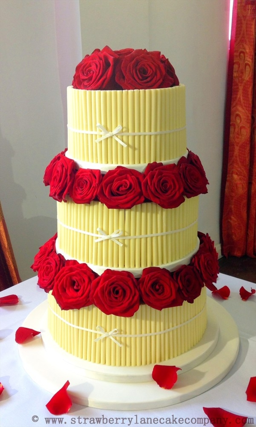 White Chocolate Cigarellos Wedding Cake With Fresh Red Roses ...