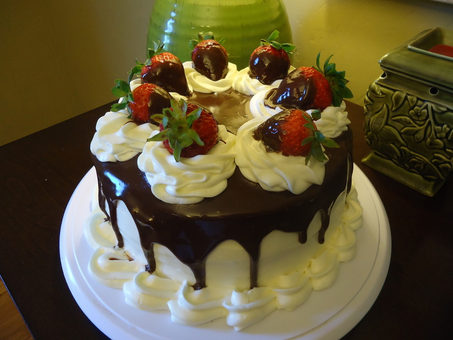 Decorating A Cake With Chocolate Dipped Strawberries