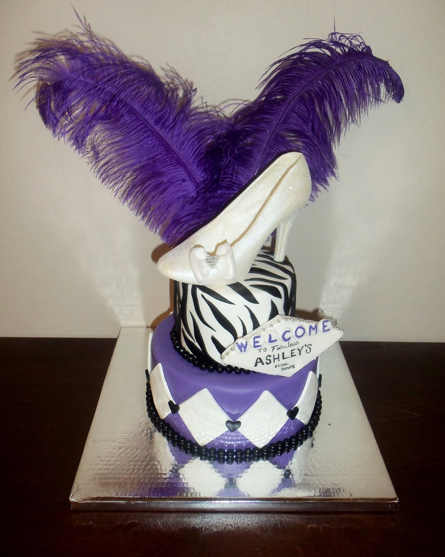 i walked into the party with this cake and it matched the decor perfectly same feathers were used in centerpieces same purple color and zebra print