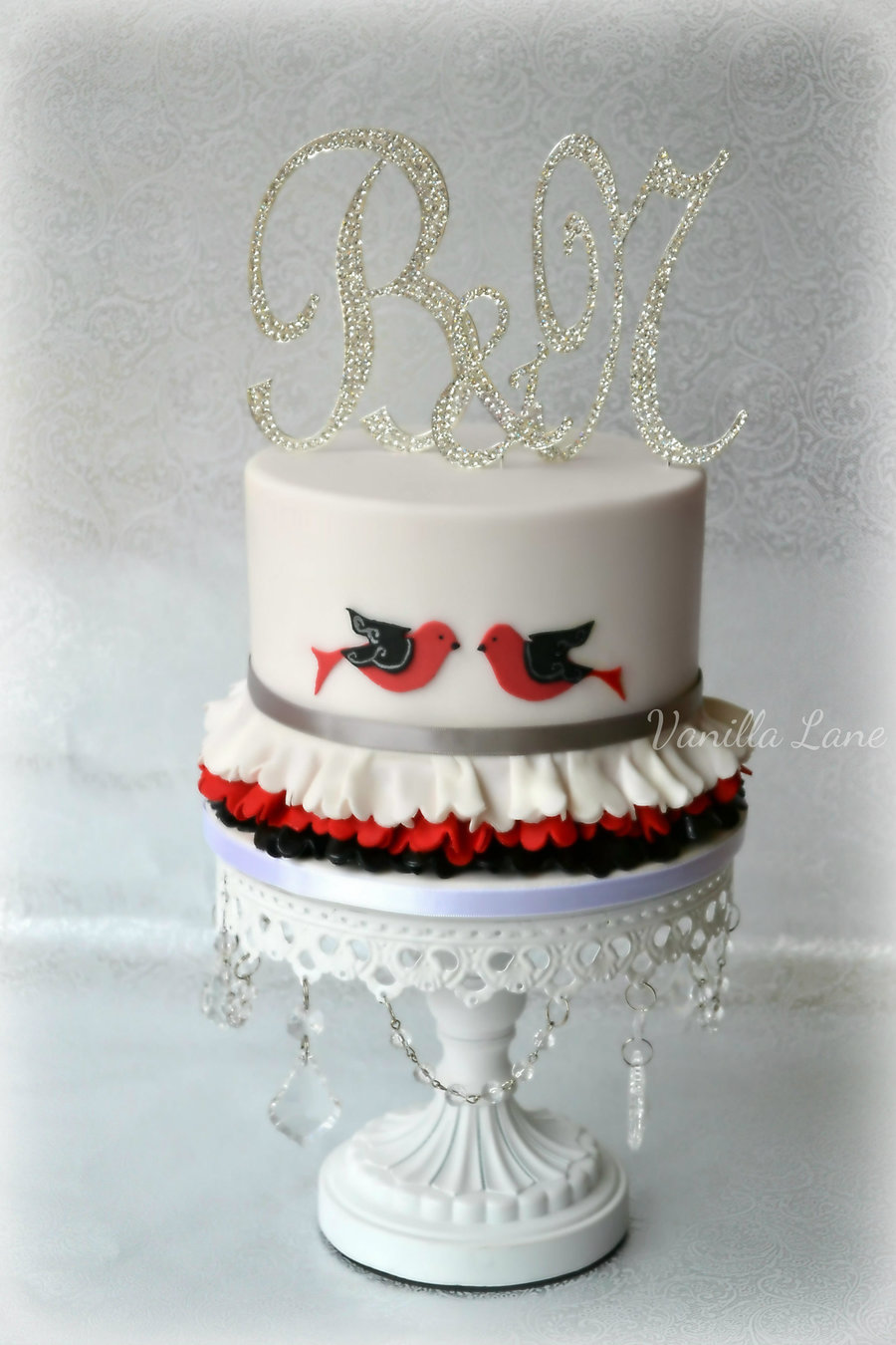 white chocolate ganache covered wedding cake lovebirds wedding cake 6 top cake was velvet covered 27250