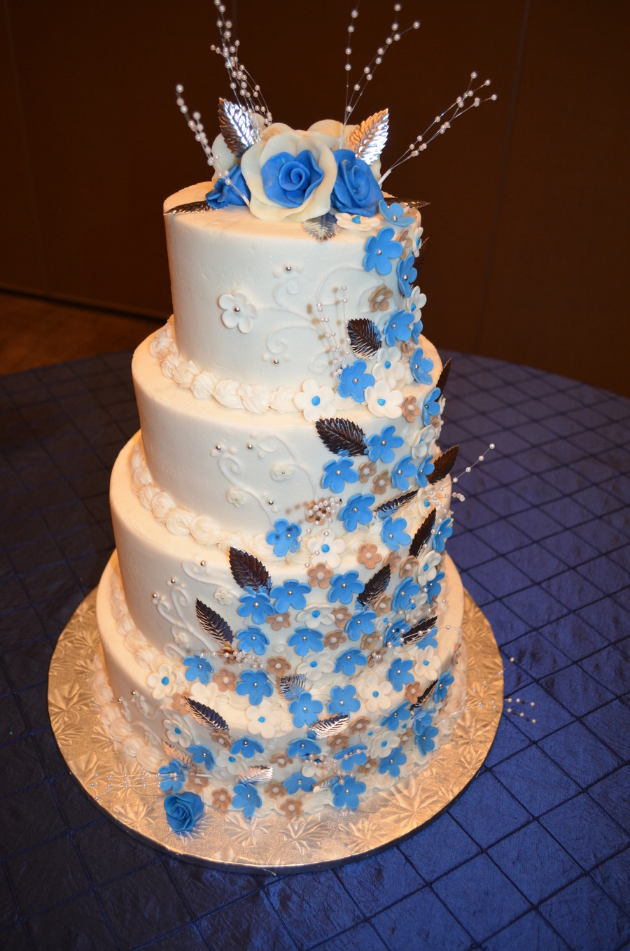 Blue And Tan Cascading Flowers on Cake Central