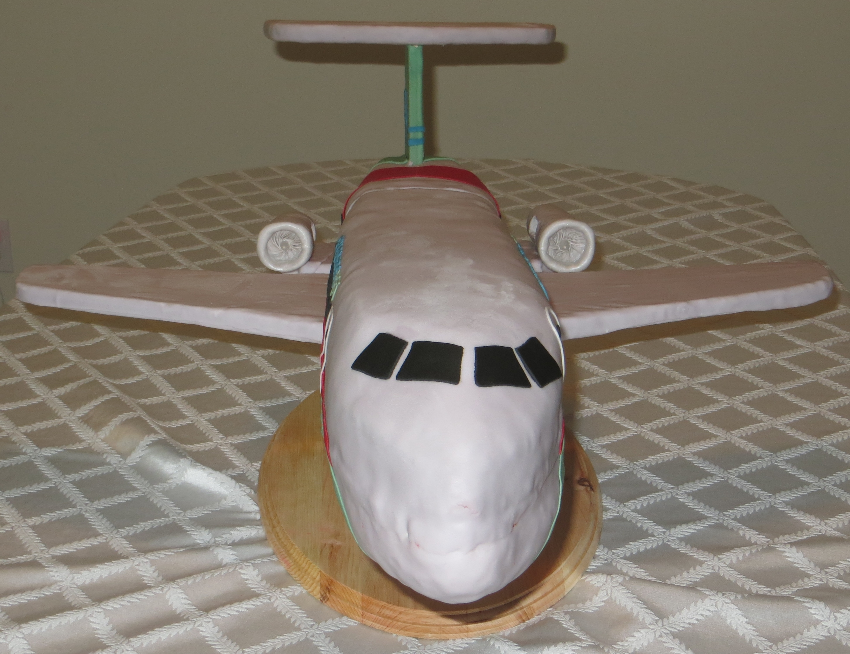 I Was Trying To Make An Embraer 145 For My Husband It A Red Velvet Cake With Cream Cheese Frosting And Covered In Fondant The Bottom RKT Use