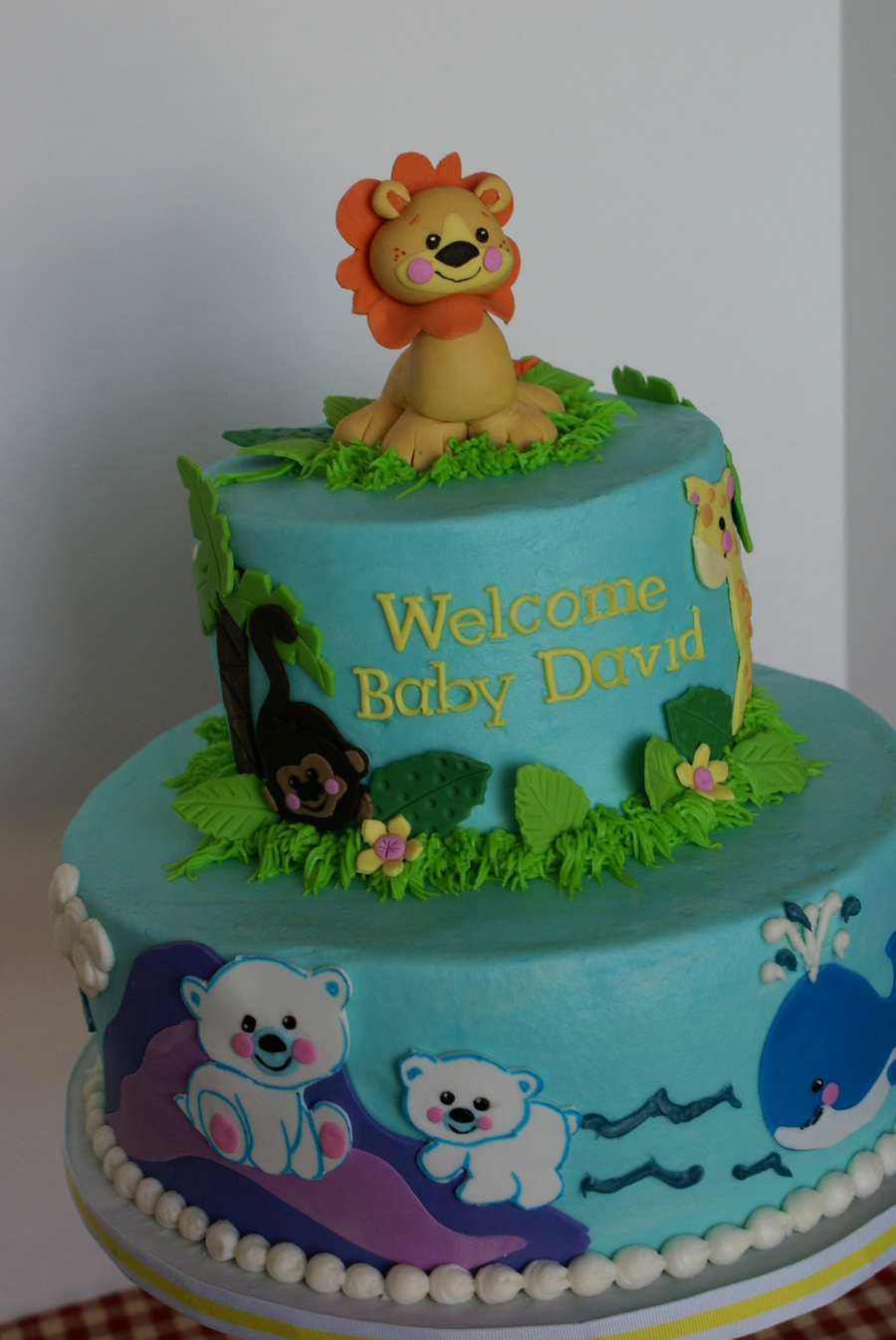 Baby boy shower zoo animal cake for Animal cake decoration