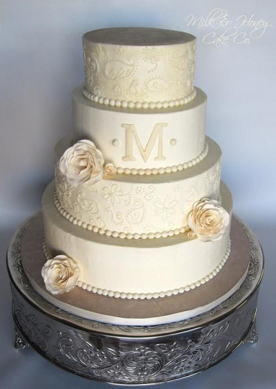 all buttercream paisley piped off white wedding cake with sugar roses pearls and a monogram tfl. Black Bedroom Furniture Sets. Home Design Ideas