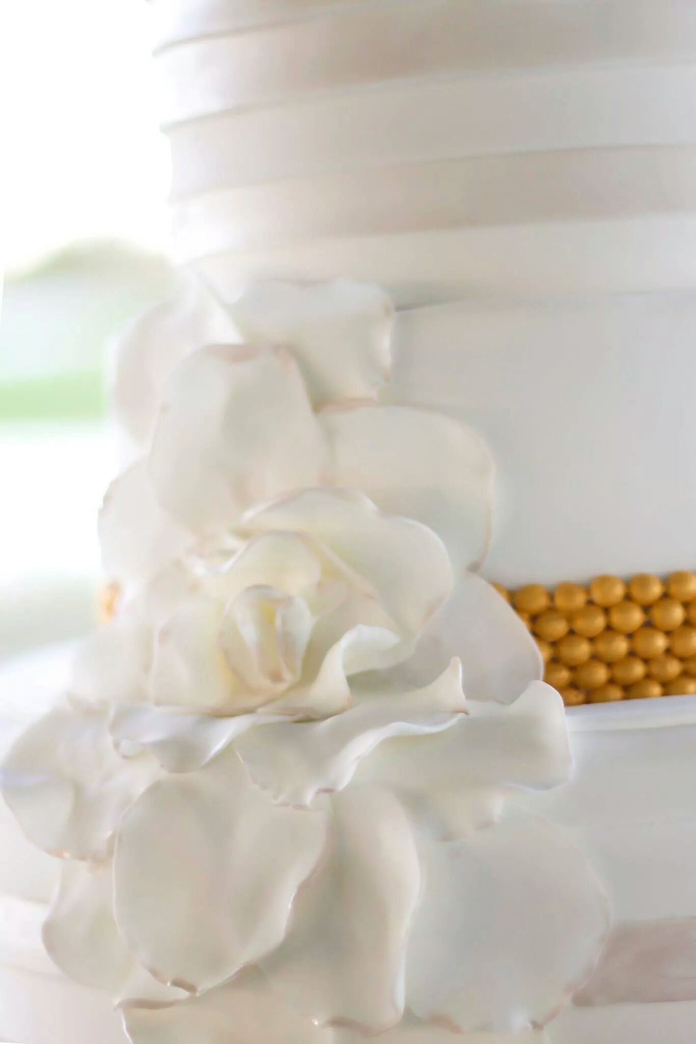 White And Pearl Wedding Cake With Horizontal Pleats