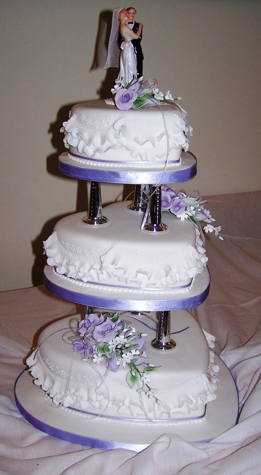top tier of wedding cake traditions 3 tier shaped cake on pillars with gumpaste flowers 21071