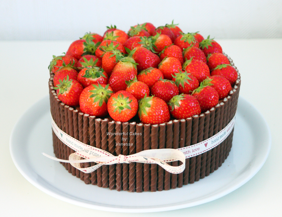 Cake Decorated With Chocolate Sticks : Strawberry Chocolate Bombdevil S Food Cake Filled With ...