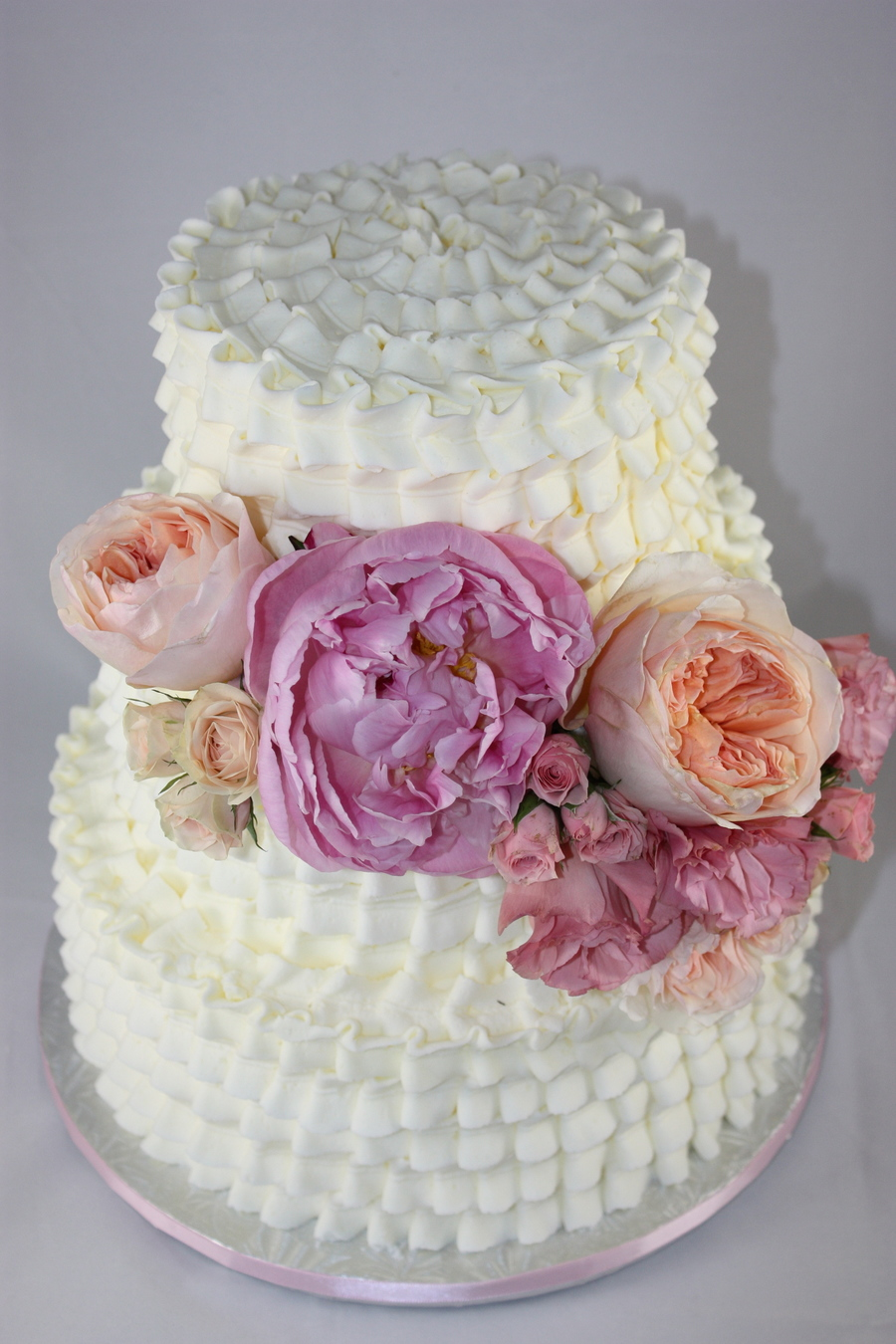 White Ruffle Buttercream Cake With Fresh Peony And Garden Roses Classic Creations Floral Design This Was A Display Cake For A Bridal Expo on Cake Central