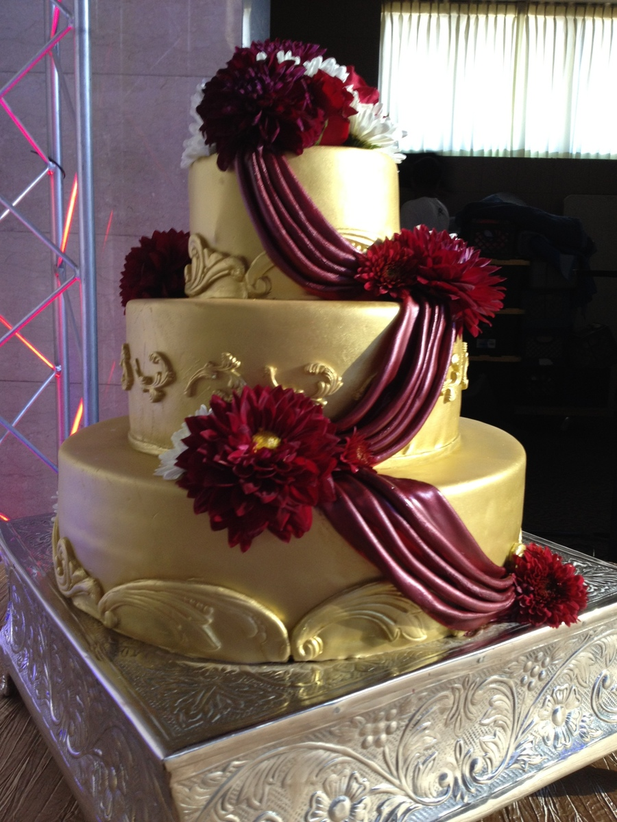 Maroon and gold wedding cakes