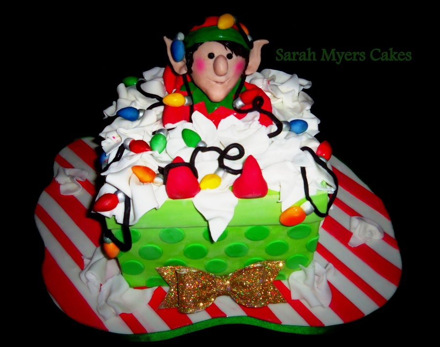 This Little Elf Has Gotten Himself All Tangled Up Cake Present Figure Lights Tissue Paper Made Of Gumpaste Amp Modeling Chocolate on Cake Central