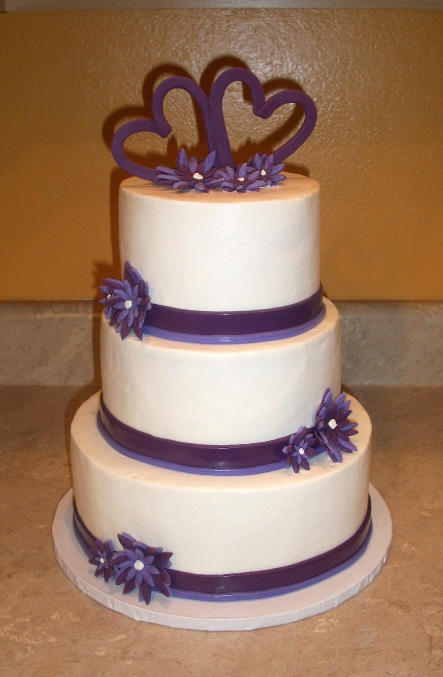 Purple Hearts And Flowers Anniversary Cake on Cake Central