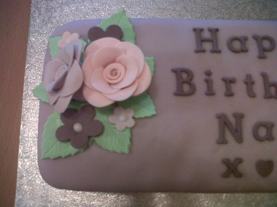 ... used flowerpaste to make the roses and flowers to add to the cake