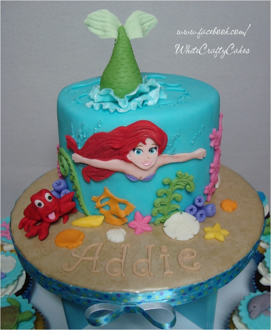The little mermaid cake and cupcake tower for Ariel cake decoration