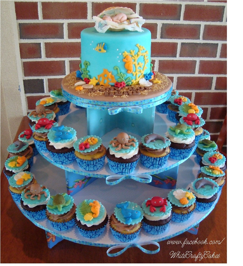 this cake and cupcake tower for a under the sea themed baby shower sea