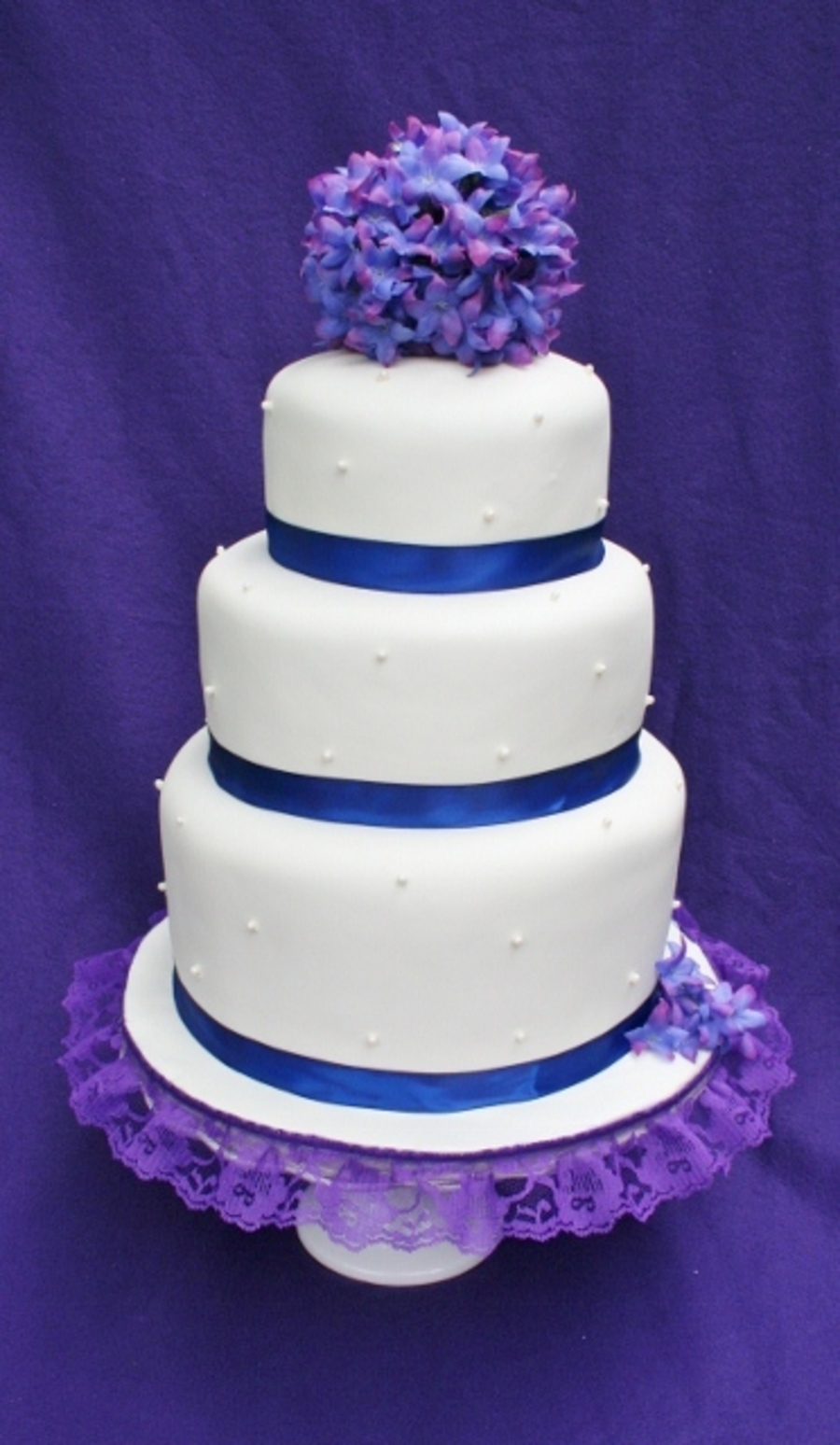 white wedding cake with purple flowers white and purple flower wedding cake cakecentral 27416