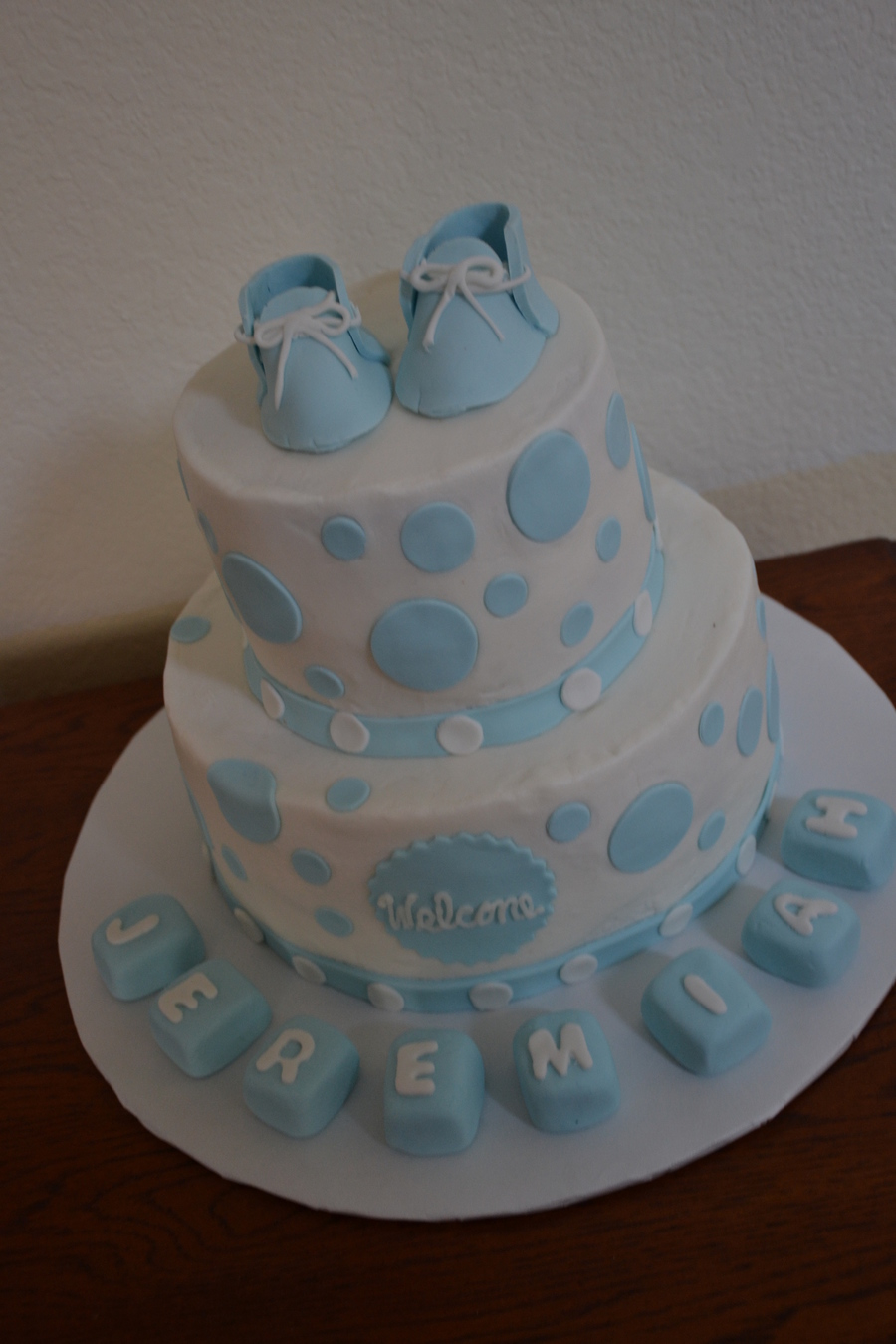 2 tier white amp baby blue with polka dots baby booties for Alphabet blocks cake decoration
