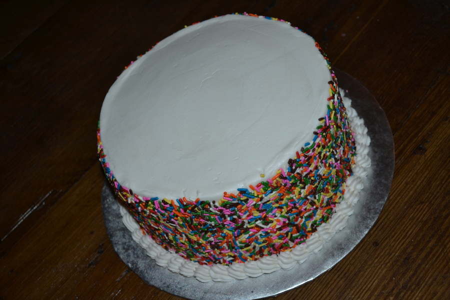 White Buttercream Birthday Cake Covered In Rainbow Sprinkles Added 50 Candles Before Party On Central