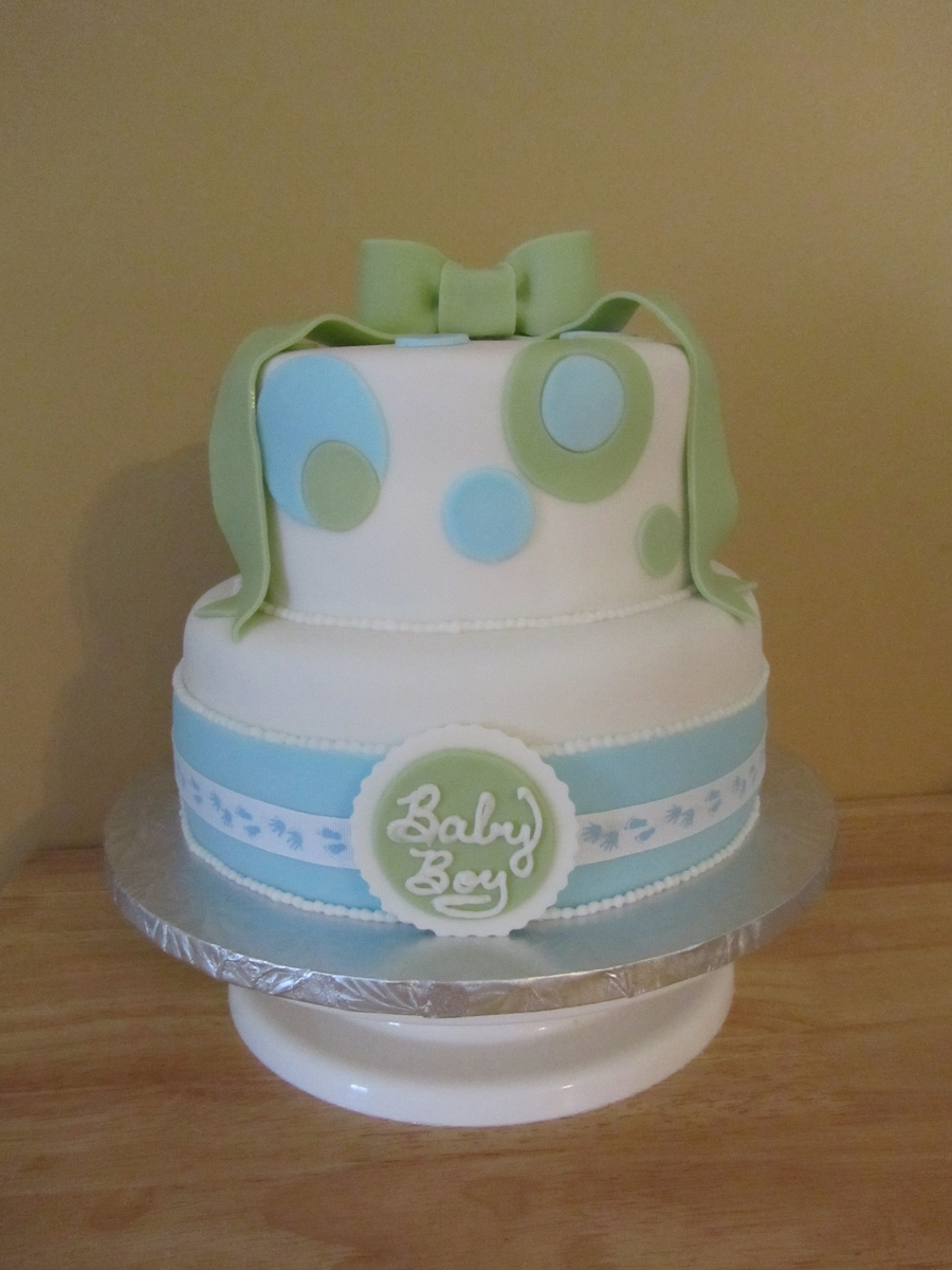 fondant blue and green baby shower cake with fondant bow topper and