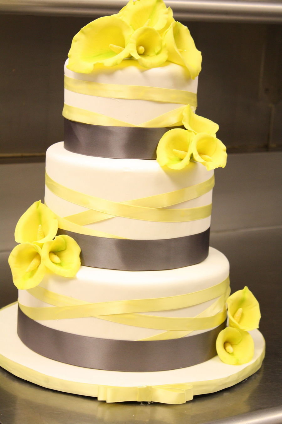 Calla Lily Wedding Cake In Grey And Yellow - CakeCentral.com