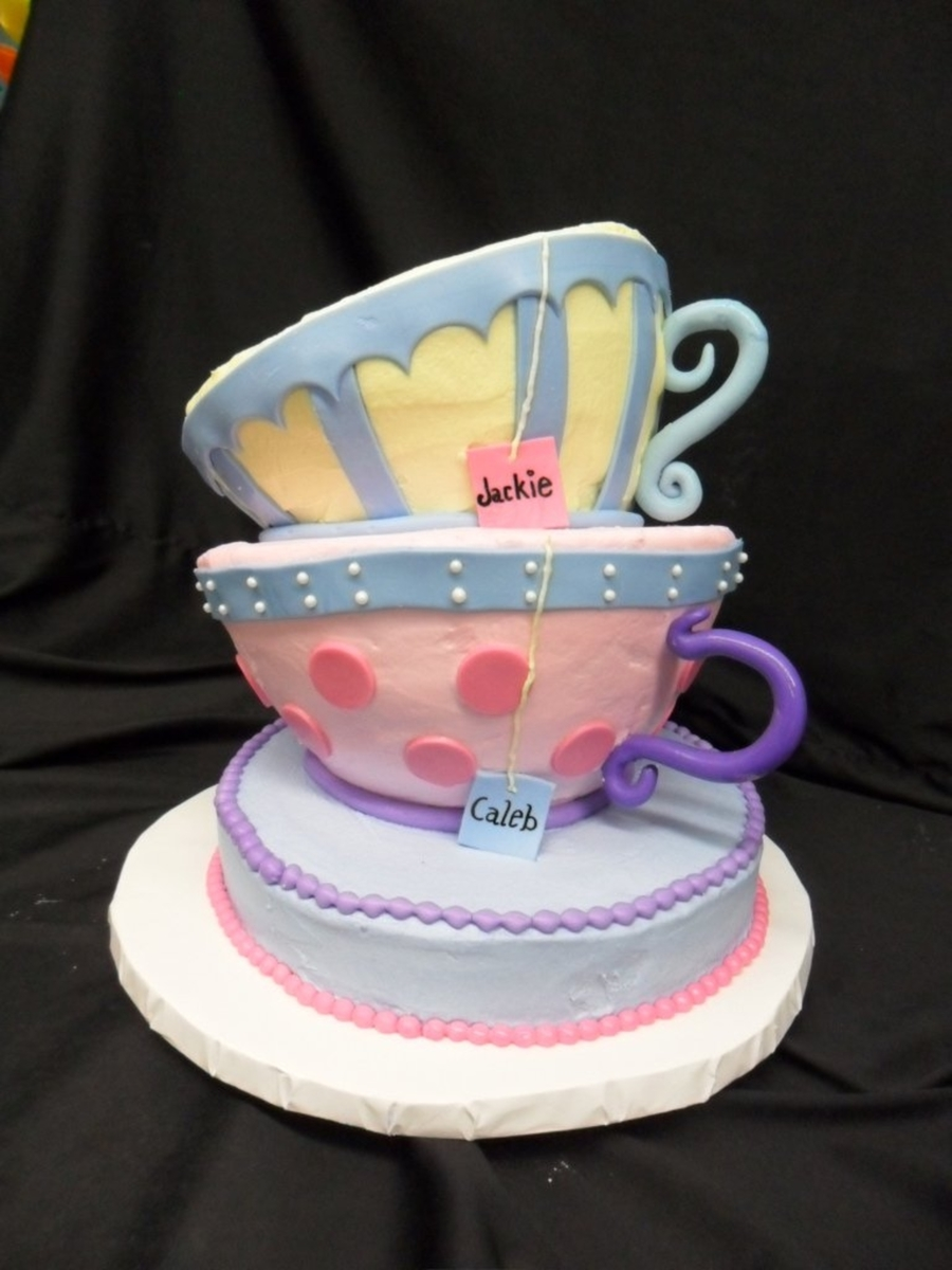 Topsy Turvy Tea Cups on Cake Central