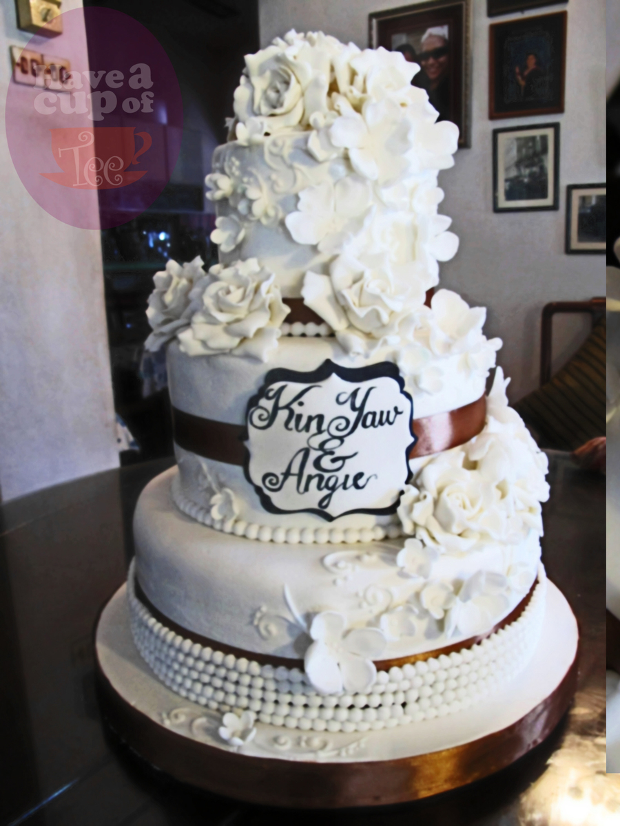 3 Tier White Wedding Cake Decorated With Beads Roses