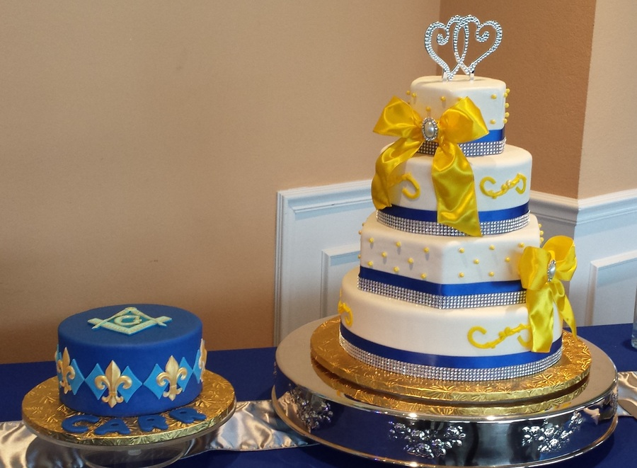 blue and yellow wedding cake ideas royal blue yellow and white wedding cake with grooms cake 11969