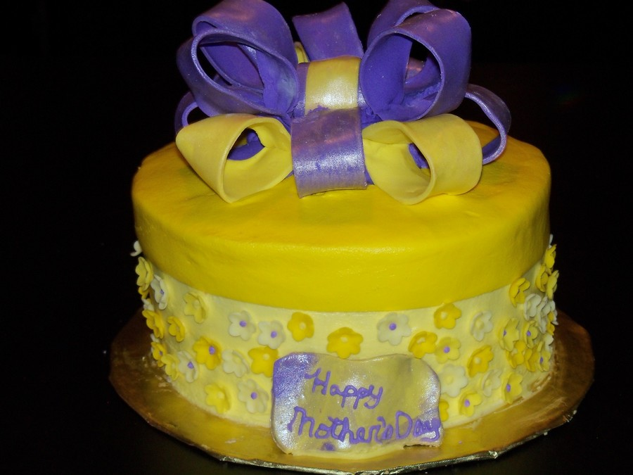 Purple and yellow mothers day cake cakecentral this is a yellow cake covered in vanilla buttercream the cake is coveed with small fondant flowers in different shades of yellow mightylinksfo