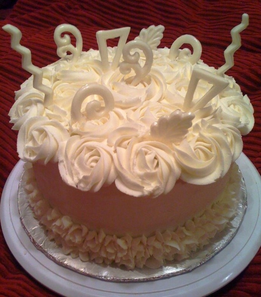 Red Velvet Cheesecake With White Chocolate Garnishes Cakecentral Com
