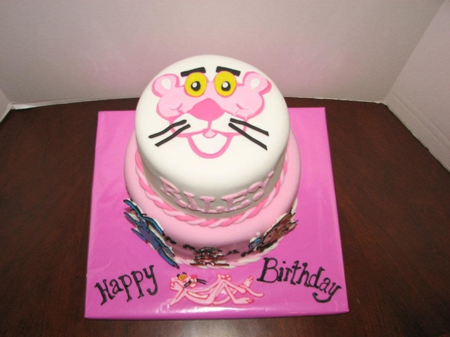 Cakes covered in fondant. Fondant pink panther on top, royal icing ...