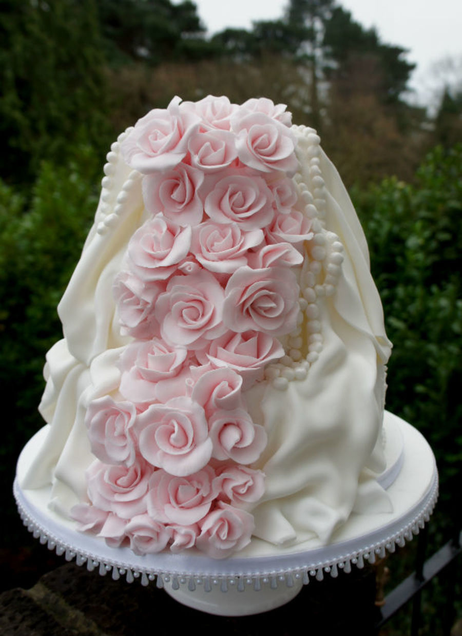 Pink And White Roses Wedding Cake With Drapes And Pearls on Cake Central