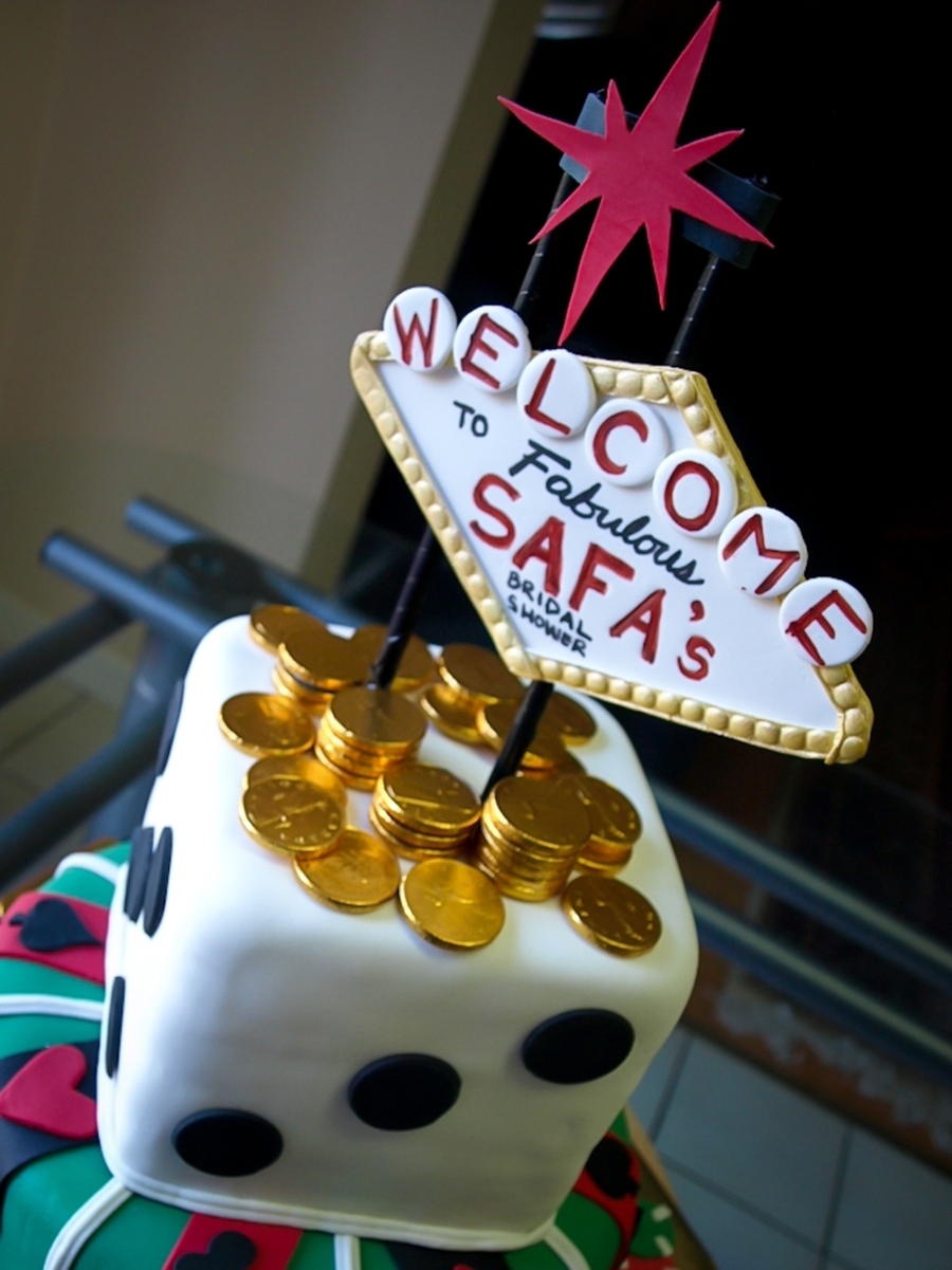 made a cake for a vegas themed bridal shower the sticks for the vegas sign are not edible but everything else is the gold coins are the chocolate coins