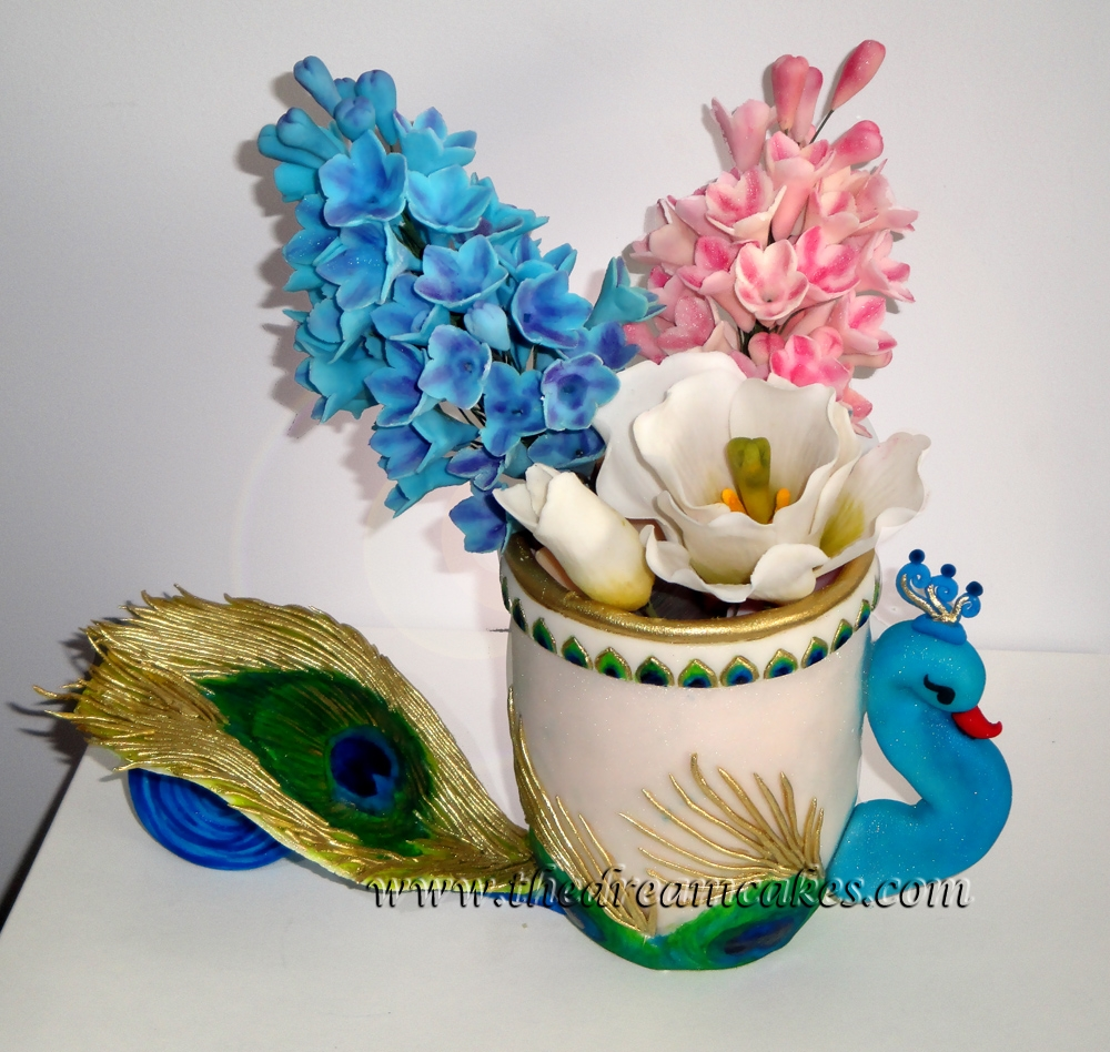 Peacock vase with gumpaste flowers cakecentral a gumpaste vase in the shape of a peacock holding gumpaste hyacinths and tulip reviewsmspy