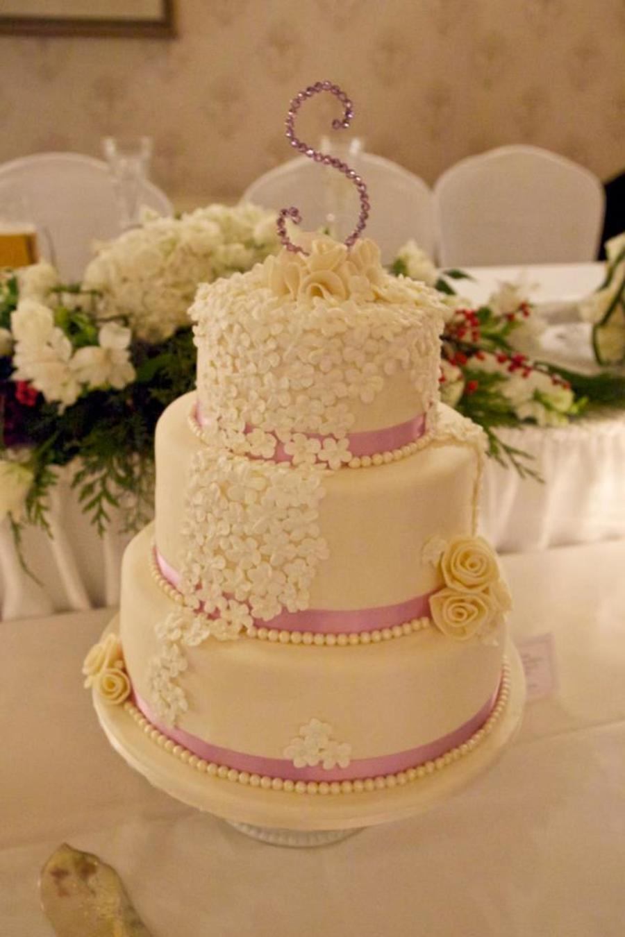Ribbon And Flowers Wedding Cake on Cake Central