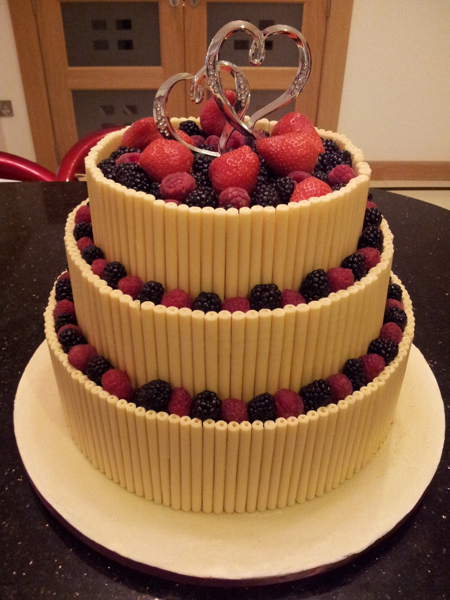 White Chocolate Cigarellos And Fruit Wedding Cake
