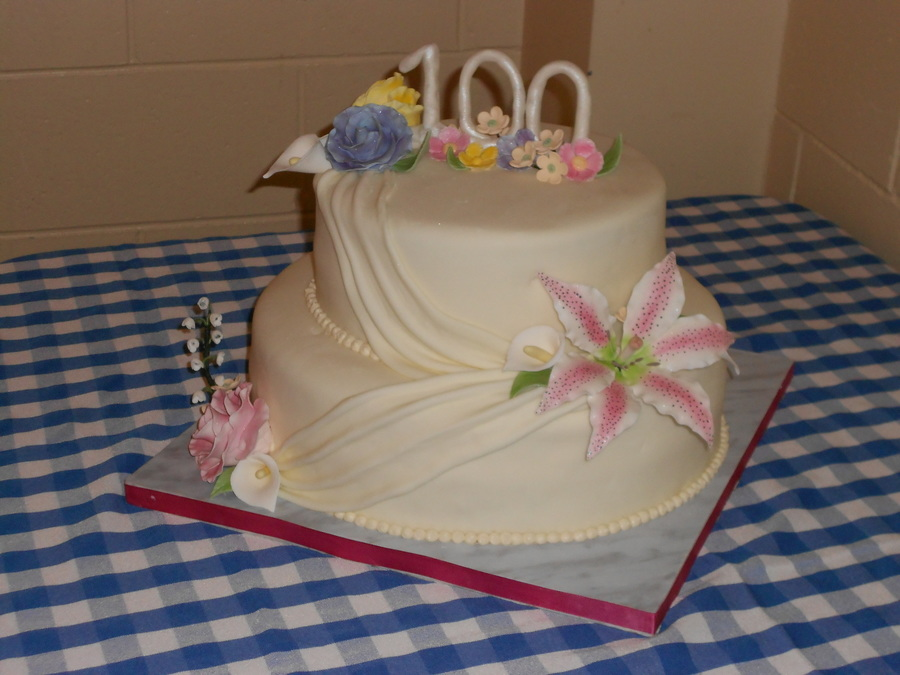 I Had The Honour Of Making My Great Aunts 100Th Birthday Cake First Time Trying The Swagdraping Effect Gumpaste Flowers  on Cake Central