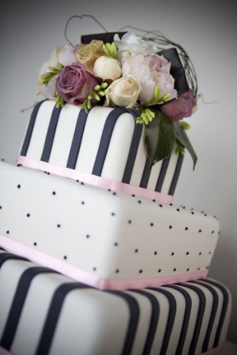 Dots And Stripes Themed Wedding Cake With Fresh Flowers ...