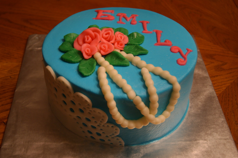 8 Round With Fondant Doily On The Side Pearls Roses Leaves On The Top Along With Recipients Name Tfl  on Cake Central