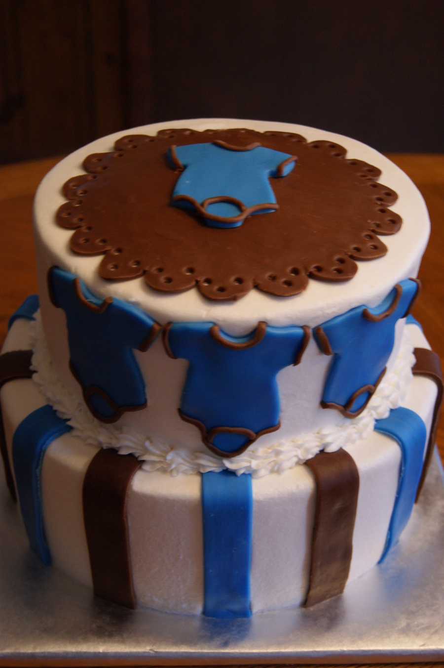 Two Tier 10 Amp 8 Blue And Brown Baby Onesie For A Boy Baby Shower on Cake Central