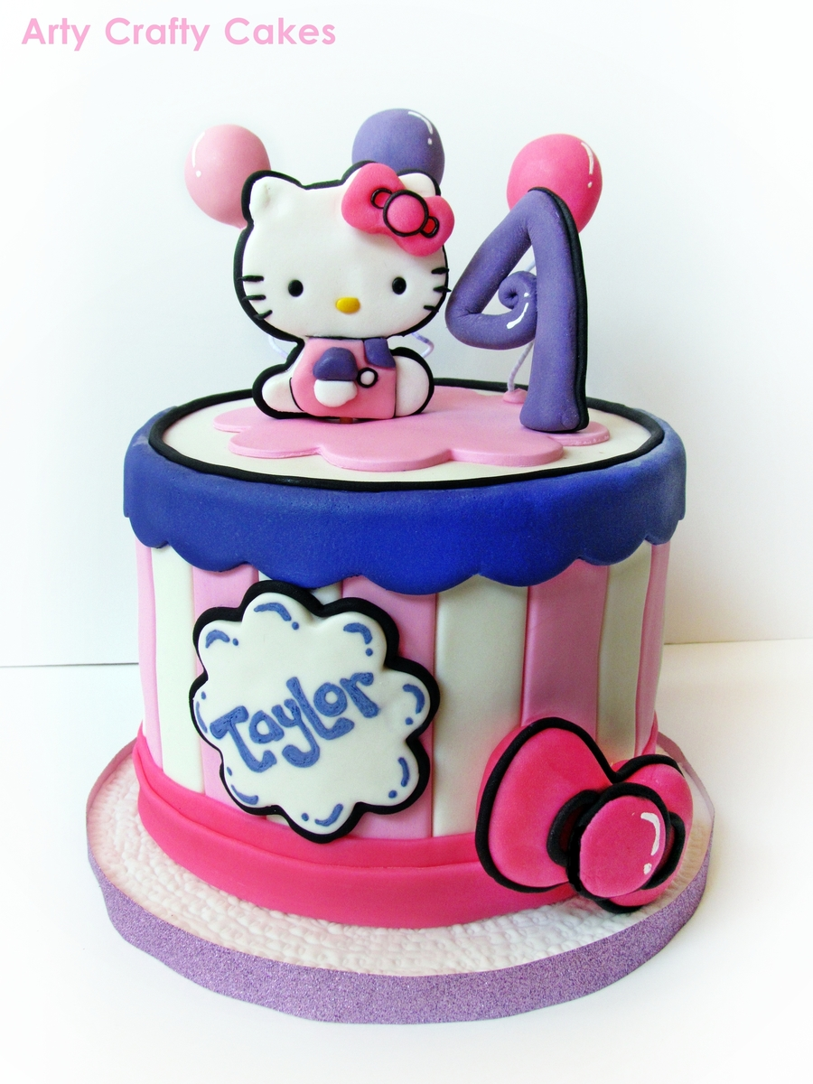 A Cute Hello Kitty Cake For A Girl That Is Celebrating Her 4 Th Birthday