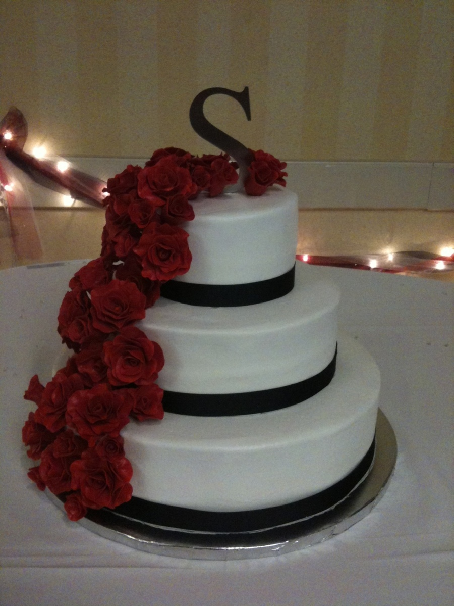 cascading red roses on buttercream wedding cake. Black Bedroom Furniture Sets. Home Design Ideas