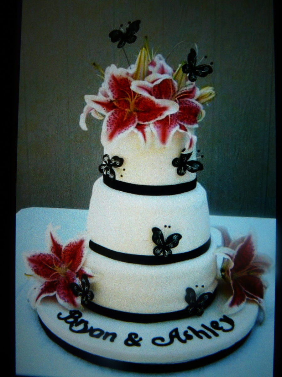 Stargazer Lilly Wedding Cake With Butterflies  on Cake Central