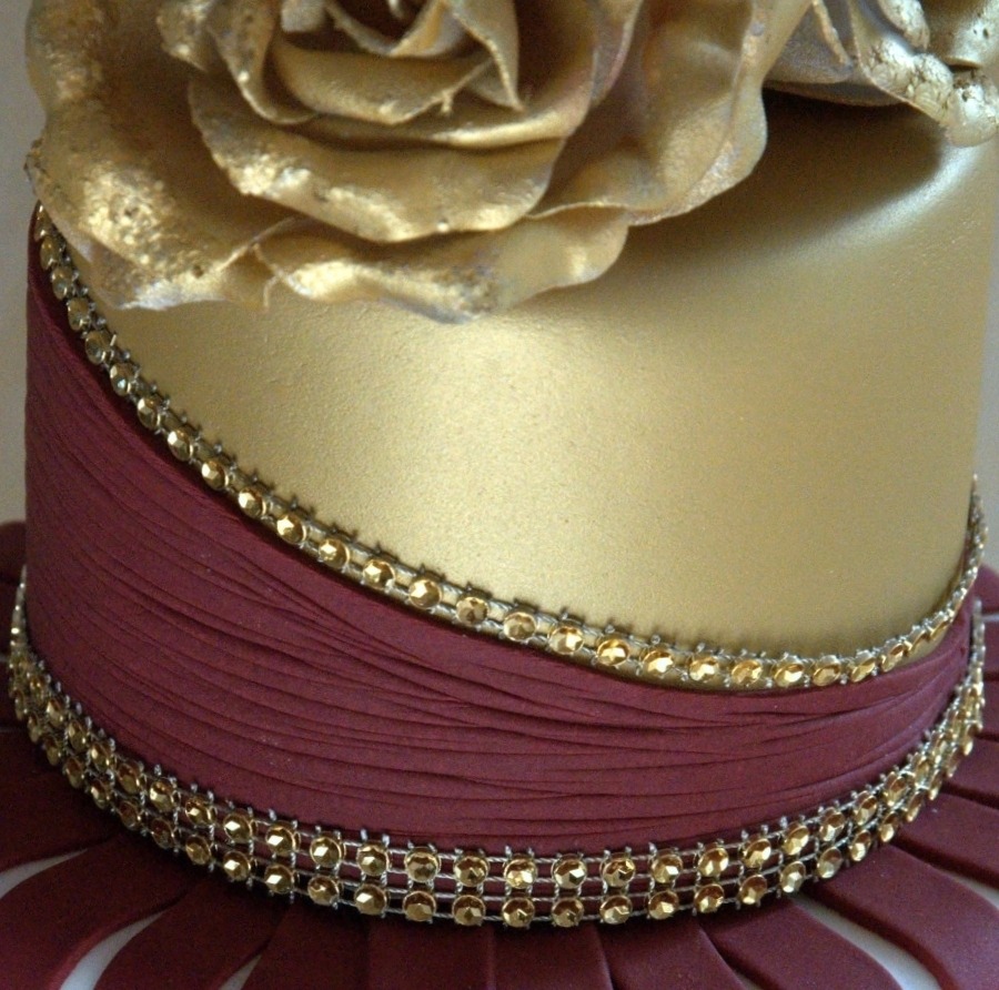 white wedding cake with gold bling gold and burgundy wedding cake with ruffles and roses 27410