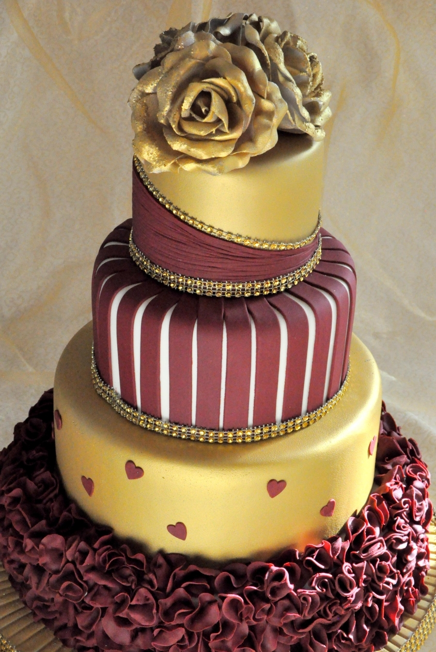 burgundy black and gold wedding cakes gold and burgundy wedding cake with ruffles and roses 12233
