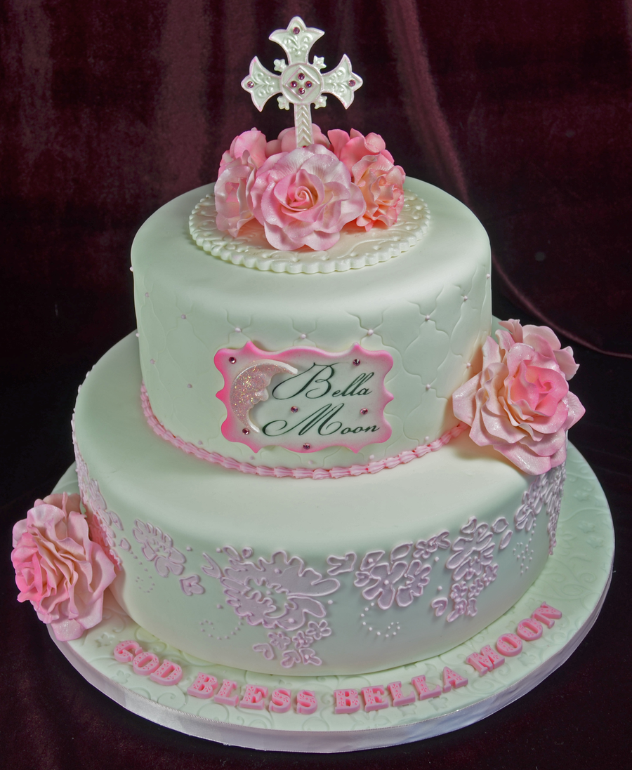 Christening cake in pink and white with pink sugar flowers sugar christening cake in pink and white with pink sugar flowers sugar cross and stencil over piping quatrefoil pattern on second tier mightylinksfo