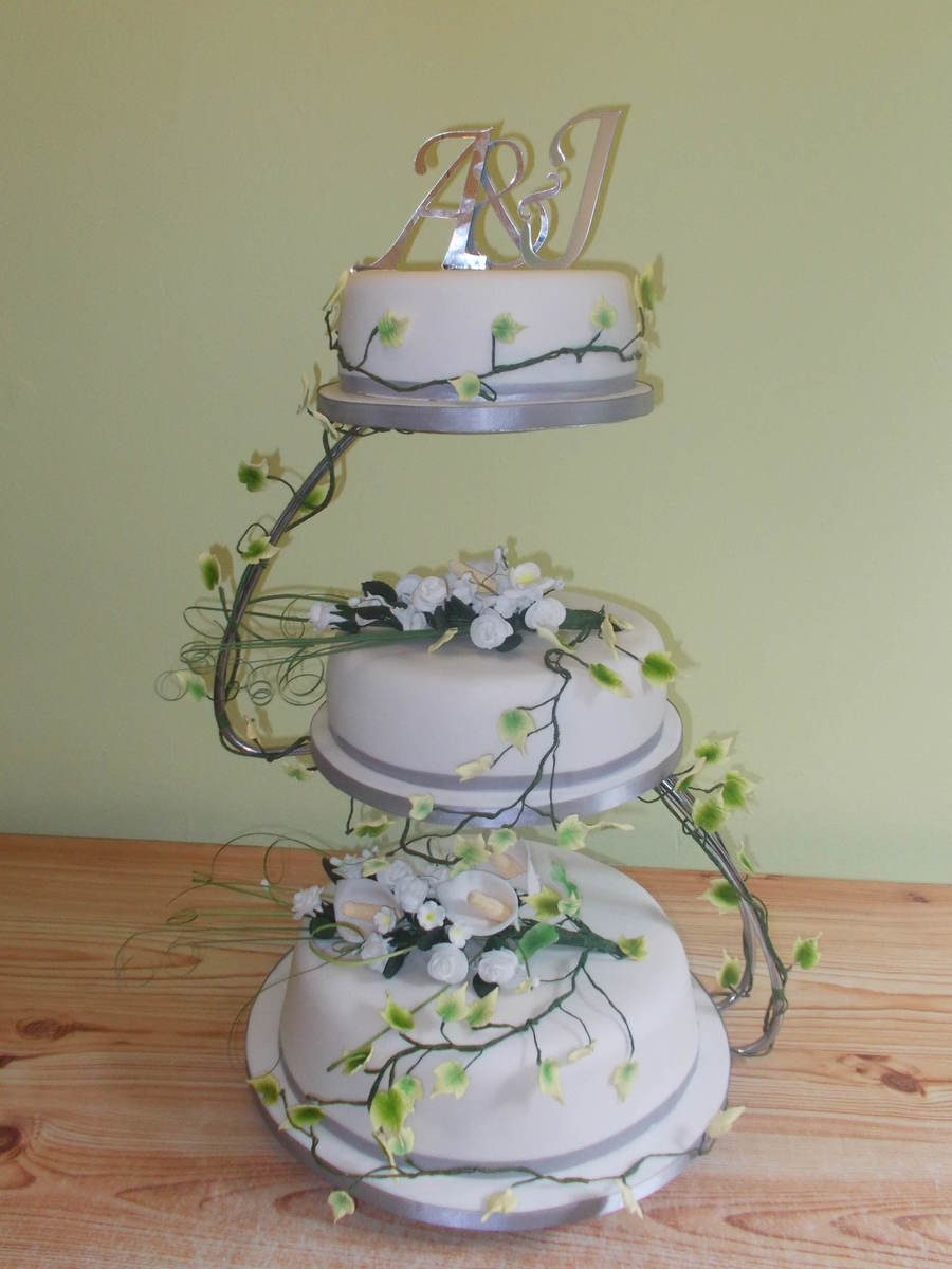 3 Tiered White Flower Wedding Cake On S Shaped Stand CakeCentralcom