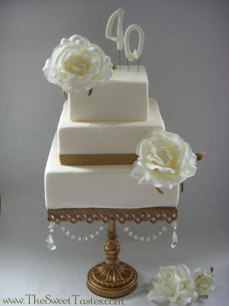 Vintage Elegance White Cakes On Gold Cake Stands From Wwwthesweettastescom on Cake Central